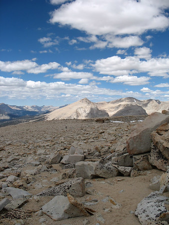 Hiking the summit plateau. In the background are Joe Devel Peak and Mount Pickering, with the Kaweah Peaks in the far distance.