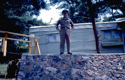 Frank standing at top of wall near his living quarters